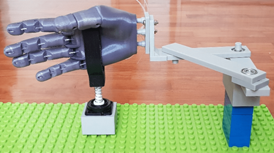 A motorised test jig was built to simulate the 'hand manoeuvre motion' for stress testing of the 3D printed joysticks.